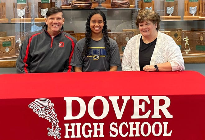 Signing a Letter of Intent is Hannah Neff seated between her father Rodney and her mother Linda.