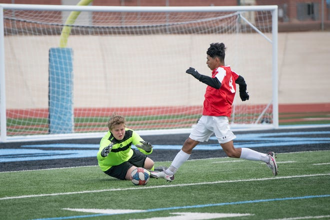 Pueblo West High School's Wilder Unwin lays out to prevent a goal by Centennial's Christian Moctezuma during their matchup on Tuesday March 23, 2021.