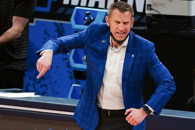 Mar 22, 2021; Indianapolis, Indiana, USA; Alabama Crimson Tide head coach Nate Oats reacts in the first half against the Maryland Terrapins in the second round of the 2021 NCAA Tournament at Bankers Life Fieldhouse. Mandatory Credit: Kirby Lee-USA TODAY Sports