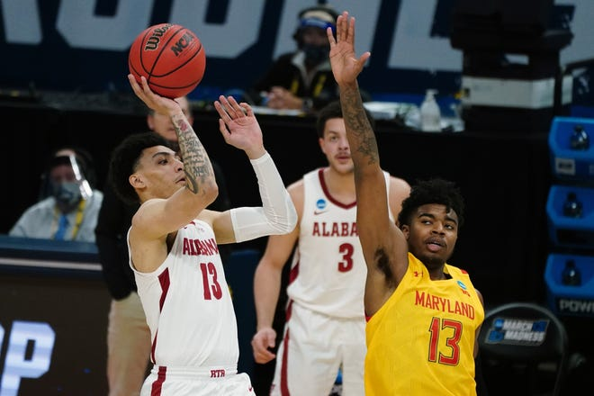 Mar 22, 2021; Indianapolis, Indiana, USA; Alabama Crimson Tide guard Jahvon Quinerly (13) shoots against Maryland Terrapins guard Hakim Hart (13) in the first half in the second round of the 2021 NCAA Tournament at Bankers Life Fieldhouse. Mandatory Credit: Kirby Lee-USA TODAY Sports