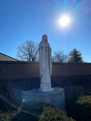 The 6-foot, 8-inch, 1,500-pound statue of Mary at Our Lady of Peace Catholic Church is expected back by May 16 after being removed for cleaning.