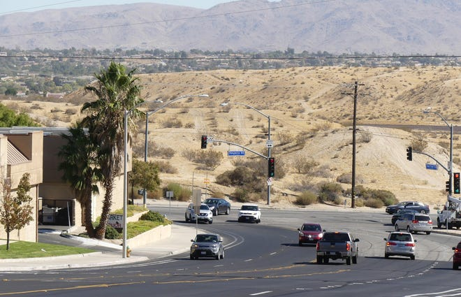 Cars travel through the Green Tree Boulevard and Hesperia Road intersection in 2019. Construction to extend Green Tree east to Ridgecrest Road could begin as early as May 2021, officials said in a meeting March 16, 2021.