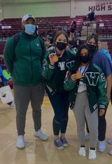 Members of the Waxahachie High School girls' powerlifting team competed last weekend at the Texas High School Women's Powerlifting Association state championship meet in Corpus Christi. Pictured are (from left) Coach Gary Mason, Lexi Chandler, Beatriz Garcia and Mia Hernandez.
