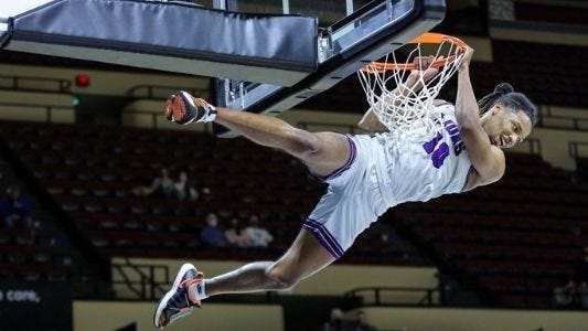 Southwestern Assemblies of God University senior Joshua Kashila throws down a dunk during the NAIA National Tournament in Kansas City, Mo. The Lions reached the national semifinals for only the second time in school history.