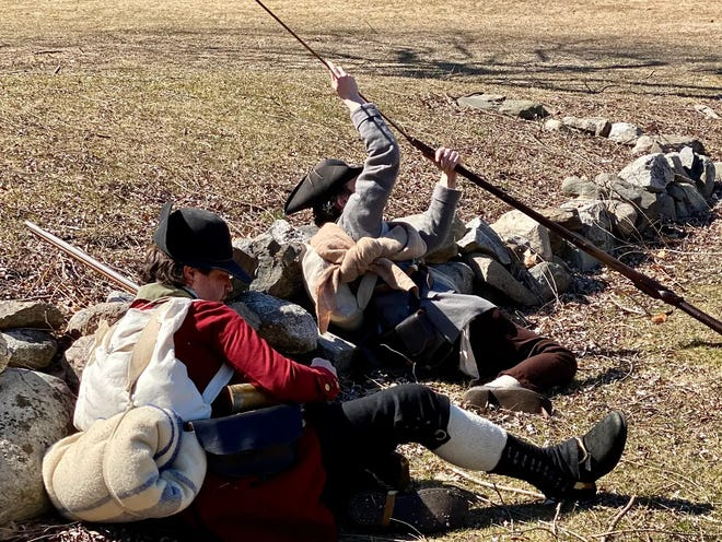 Local history enthusiasts reloaded their muskets during a recent reenactment.