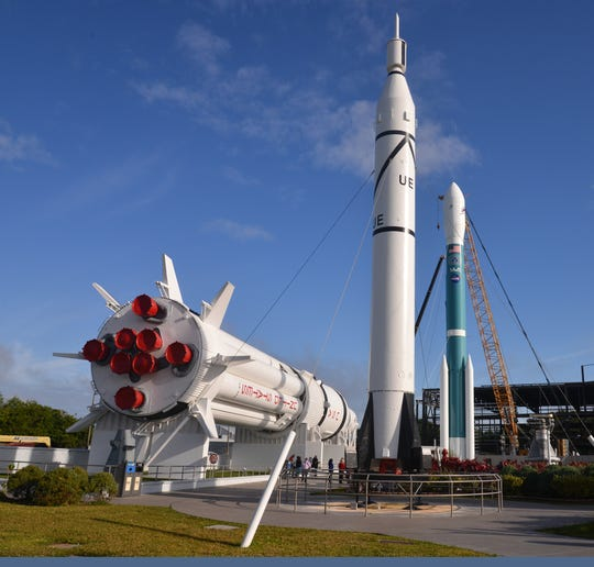 The Delta II ( blue rocket on the right) stands in the rocket garden with the Saturn IB rocket  and a Juno 1 rocket  to the left of it. The media was invited to attend the grand opening of the Delta II exhibit in the Rocket Garden at the Kennedy Space Center Visitor Complex Tuesday morning.