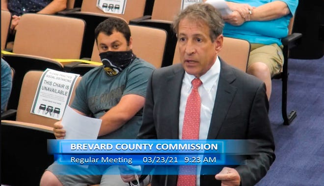 Omni Healthcare President and Chief Executive Officer Dr. Craig Deligdish addresses Brevard County commissioners on Tuesday.