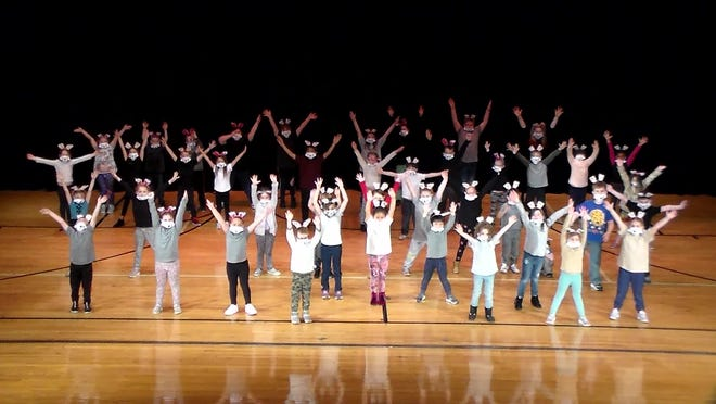 """More than 100 students at Bucyrus Elementary make up the cast of """"Disney's 101 Damatians KIDS"""" that will be available to view online this weekend."""