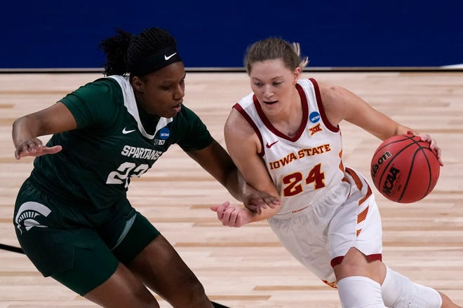 Iowa State guard Ashley Joens (24) drives past Michigan State guard Janai Crooms (23) during the first half of an NCAA Tournament game at the Alamodome in San Antonio on Monday, March 22, 2021.