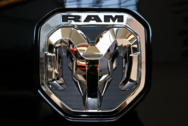 This Feb. 13, 2020 photo shows the Ram truck logo at the 2020 Pittsburgh International Auto Show in Pittsburgh.  The company that makes heavy-duty diesel Ram trucks is telling some owners to park them outdoors due to the risk of an engine fire. Fiat Chrysler, now part of Stellantis, is recalling just over 20,000 of the trucks mainly in the U.S. and Canada.