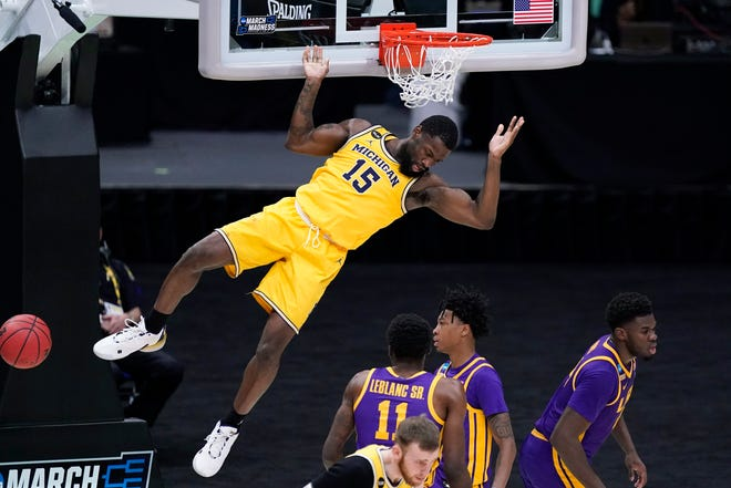 Michigan guard Chaundee Brown dunks the ball during the second half of the 86-78 win over LSU in the second round of the NCAA tournament on Monday, March 22, 2021, in Indianapolis.