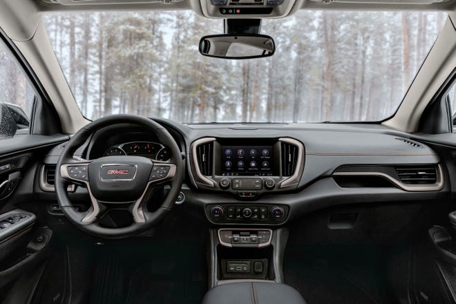 """The 2022 GMC Terrain interior takes cues from its Sierra pickup big brother and includes unique items like a dash-mounted """"trigger shifter."""""""