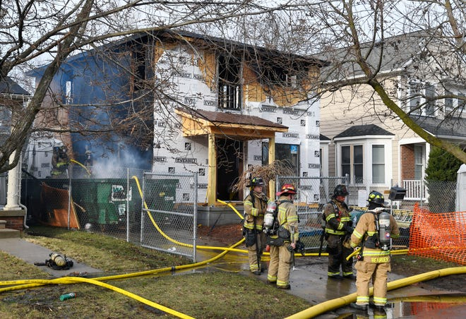 Firefighters finish up on a house, under construction, fire on the 1200 block of E. Lincoln in Birmingham, Michigan on March 23, 2021.