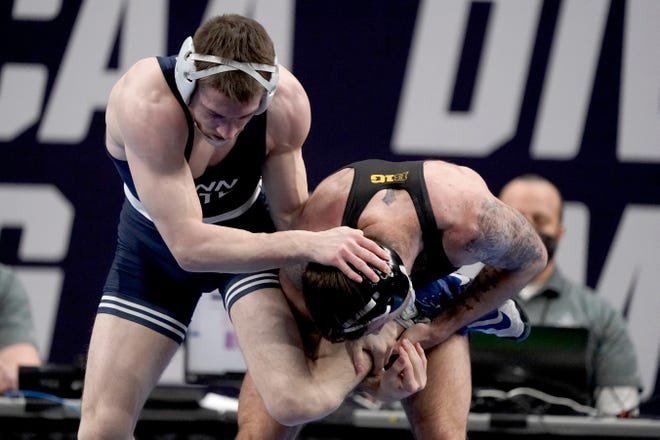 Iowa's Jaydin Eierman, right, takes on Penn State's Nick Lee during their 141-pound match in the finals of the NCAA wrestling championships Saturday, March 20, 2021, in St. Louis. (AP Photo/Jeff Roberson)