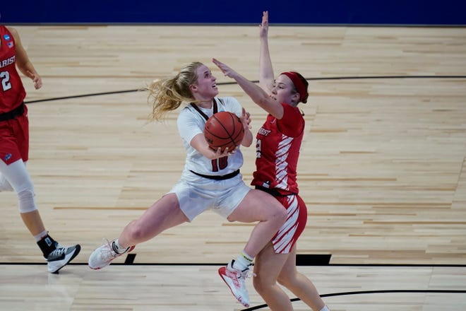 Louisville guard Hailey Van Lith (10) drives to the basket against Marist guard Anabel Ellison (22) during the first half of a college basketball game in the first round of the women's NCAA tournament at the Alamodome in San Antonio, Monday, March 22, 2021. (AP Photo/Eric Gay)