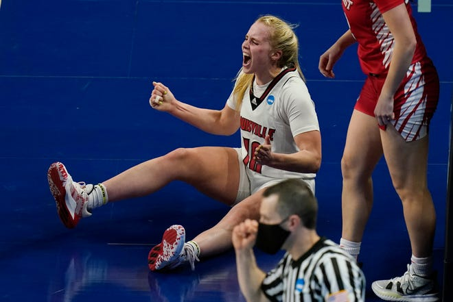 Louisville guard Hailey Van Lith (10) reacts after a favorable call during the first half of a college basketball game against Marist in the first round of the women's NCAA tournament at the Alamodome in San Antonio, Monday, March 22, 2021. (AP Photo/Eric Gay)