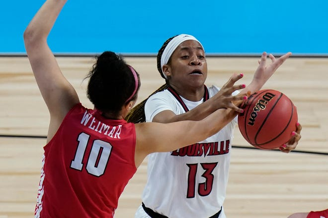 Marist forward Caitlin Weimar (10) and Louisville guard Merissah Russell (13) scramble for a rebound during the second half of a college basketball game in the first round of the women's NCAA tournament at the Alamodome in San Antonio, Monday, March 22, 2021. (AP Photo/Eric Gay)