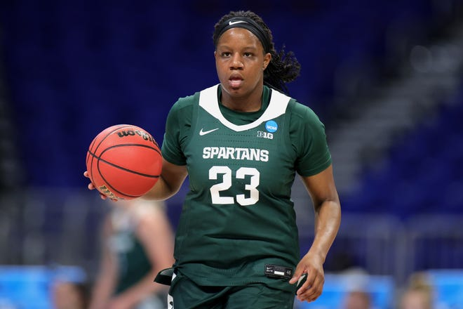 SAN ANTONIO, TEXAS - MARCH 22: Janai Crooms #23 of the Michigan State Spartans controls the ball against the Iowa State Cyclones during the first half in the first round game of the 2021 NCAA Women's Basketball Tournament at the Alamodome on March 22, 2021 in San Antonio, Texas. (Photo by Carmen Mandato/Getty Images)