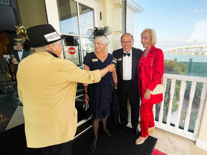 """The paparazzi were in full force at the Marco Island Yacht Club's """"Hooray for Hollywood"""" event.  Reporter MA Harlacker, left, interviews Margaret and Doug DeCamp and Myrt Rose."""