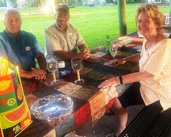 Charlie Schwalja, Ed and Ginny Bauersfield at the steak fry.