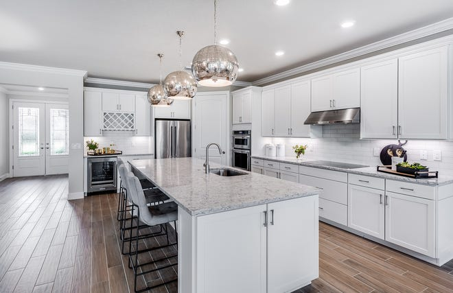 In River Hall Country Club, the Pinnacle model is a Lee BIA Parade of Homes winner.