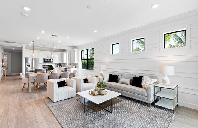 The Ellenwood model, another Lee BIA Parade of Homes winner in Esplanade Lake Club, features a great room design ideal for everyday entertaining.