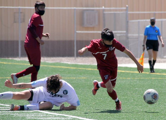 Cipriano Gonzalez (7) goes on the attack during Saturday's District 3-5A soccer match against Onate High. Gonzalez scored Deming's lone goal in a 3-1 loss to the Knights.