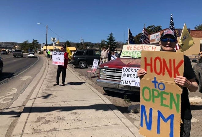 """About 30 people gathered for a """"No Lockdown, Yes Freedom""""rally at Swan Street and Highway 180 in Silver City on Saturday, March 20, 2021"""