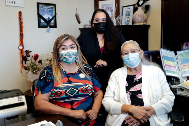 Faith Morreo, left, Michelle Morreo, middle, and Christina Morreo, right, pose for a photo inside the Torres Martinez language building on Monday, March 22, 2021, in Thermal, Calif.