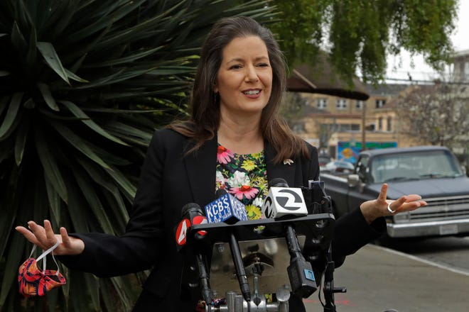 """Oakland Mayor Libby Schaaf announced a privately funded program that will give low-income families of color $500 per month with no rules on how they can spend it on Tuesday, March 23, 2021. The program in Oakland is the latest example of """"guaranteed income,"""" an idea that giving poor people a set amount of money each month will ease the stresses of poverty that contribute to poor health and hinder their ability to find full-time work. (AP Photo/Ben Margot, File)"""