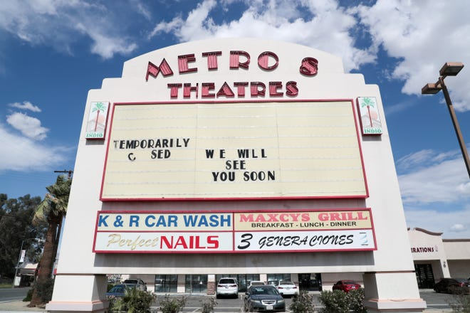 A sign for Regal Indio Metro theater states it is closed on Tuesday, March 23, 2021, in Indio, Calif. Regal Cinemas rented the building from the City of Indio and informed the city in January the company wished to terminate the lease.