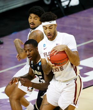 Florida State Seminoles guard Anthony Polite (2) controls the ball against Colorado Buffaloes guard McKinley Wright IV (25) in the first half during the second round of the 2021 NCAA Tournament on Monday, March 22, 2021, at Indiana Farmers Coliseum in Indianapolis, Ind.
