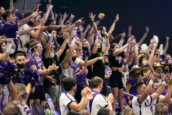 March 6, 2021; Phoenix, AZ, USA; Grand Canyon fans celebrate their win at Grand Canyon University Arena on March 6, 2021. Credit: Meg Potter/The Arizona Republic