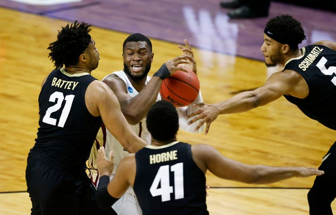 Florida State Seminoles forward RaiQuan Gray (1) is pressured by Colorado Buffaloes forward Evan Battey (21) in the first half during the second round of the 2021 NCAA Tournament on Monday, March 22, 2021, at Indiana Farmers Coliseum in Indianapolis, Ind.