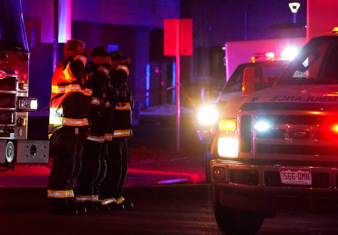 Firefighters salute an ambulance as it leaves a King Soopers grocery store where authorities say multiple people have been killed in a shooting, Monday, March 22, 2021, in Boulder, Colo. (AP Photo/David Zalubowski)