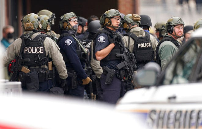 Police work on the scene outside a King Soopers grocery store where a shooting took place Monday, March 22, 2021, in Boulder, Colo. (AP Photo/David Zalubowski)
