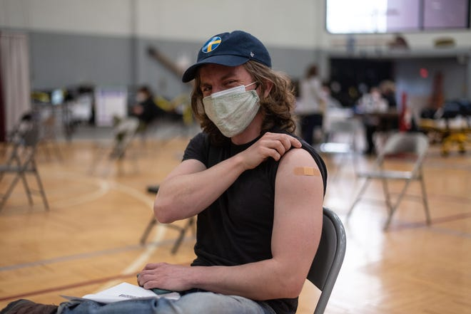 Will Rose, 25, traveled from his home in Manhattan to receive his COVID-19 vaccination at SUNY Potsdam on Thursday, March 11, 2021.