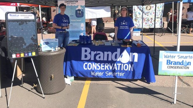 Brandon Water Conservation Committee members Amada Viau-Hopkins (left) and Trudy Papka run the booth at the Brandon Biz Bash last September.
