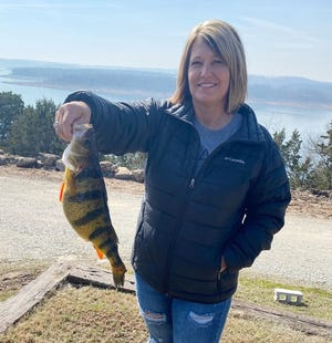 Sharon Christopher, of Cedar Hill, caught a new state record yellow perch. Christopher was fishing at Bull Shoals Lake March 7 when she caught the 2-pound, 7-ounce fish.