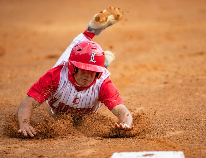 Leon's Eddie Castillo (22) dives into third base. Leon beat Baker County 4-3 on Tuesday, March 23, 2021.