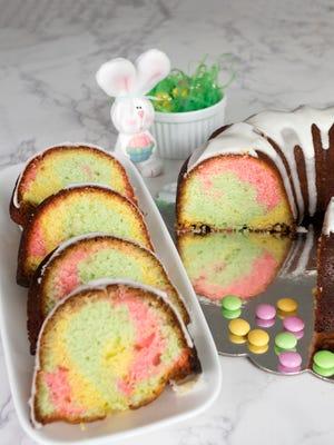 Easter Surprise Lemon Bundt Cake looks like springtime and is topped with a bright lemon glaze.