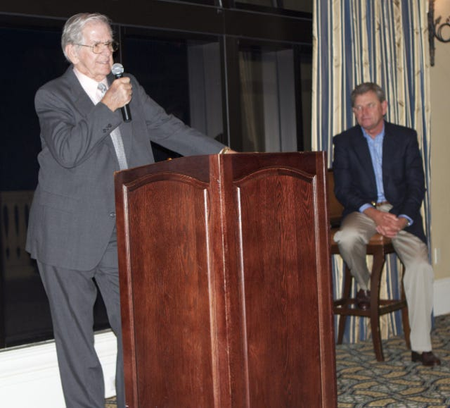 Longtime golf journalist Larry Bush inducted into the Palm Beach County Sports Hall of Fame in 2000. Nick Price can be seen in the background.