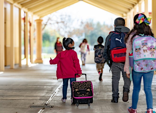 Students head for classrooms at Annie R. Mitchell Elementary School on Thursday, March 18, 2021.