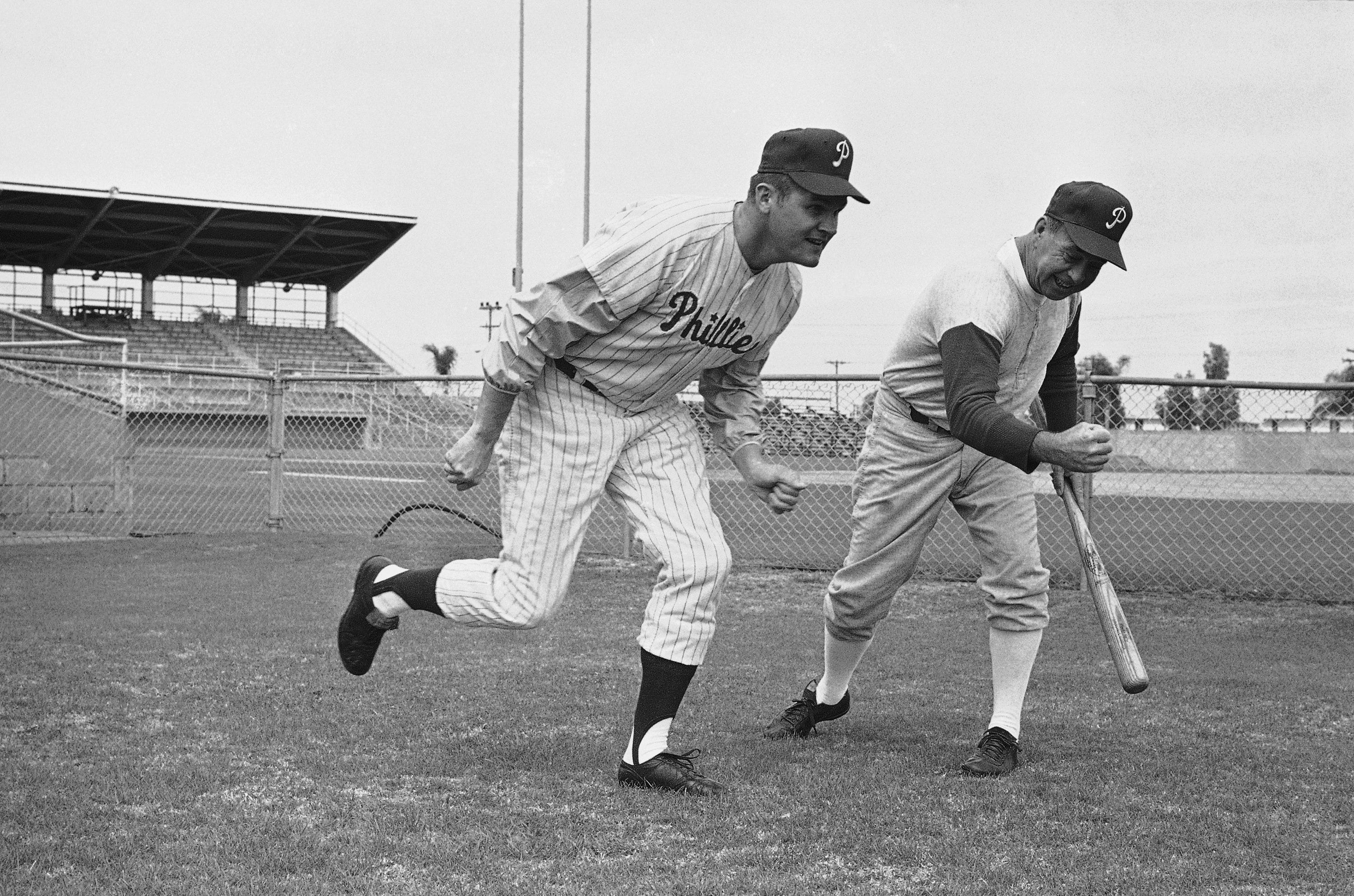 Philadelphia Phillies pitcher Chris Short is off and running as he begins training at club?s spring training camp in Clearwater, Florida on Feb. 19, 1968. Coach George Myatt gets Short on his way in the running drill. The first spring training for the Phillies is scheduled on Friday. Short won nine games while losing eleven last season. (AP Photo/PS)