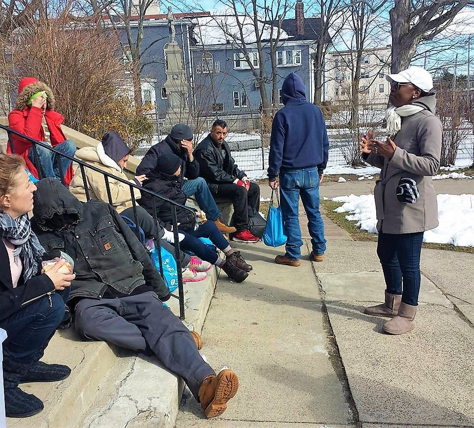 Lovern Gordon, right, speaks to a group of homeless people near Boston.