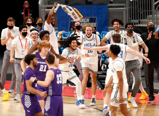 UCLA players celebrate after defeating Abilene Christian during the second round of the 2021 NCAA Tournament on Monday, March 22, 2021, at Bankers Life Fieldhouse.
