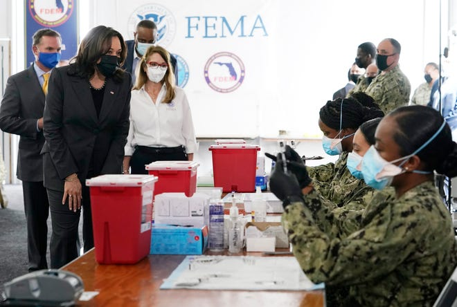 FEMA regional administrator Gracie Szczech, center, takes Vice President Kamala Harris on a tour of the Jacksonville Community Vaccination Center in Florida, where members of the Navy prepare Pfizer vaccines March 22.