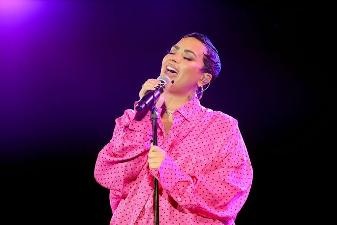 """Demi Lovato performs onstage during the Los Angeles drive-in premiere for her YouTube docuseries """"Demi Lovato: Dancing With The Devil"""" at The Beverly Hilton Monday."""