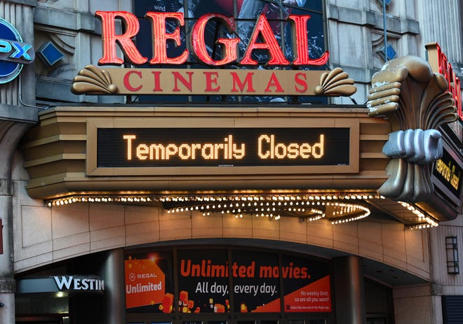 Regal Cinemas on 42nd Street in New York City is temporarily closed due to COVID-19 on March 5. Regal, the second-largest movie theater chain in the U.S., will reopen its theaters including three in Greater Akron by the end of May.