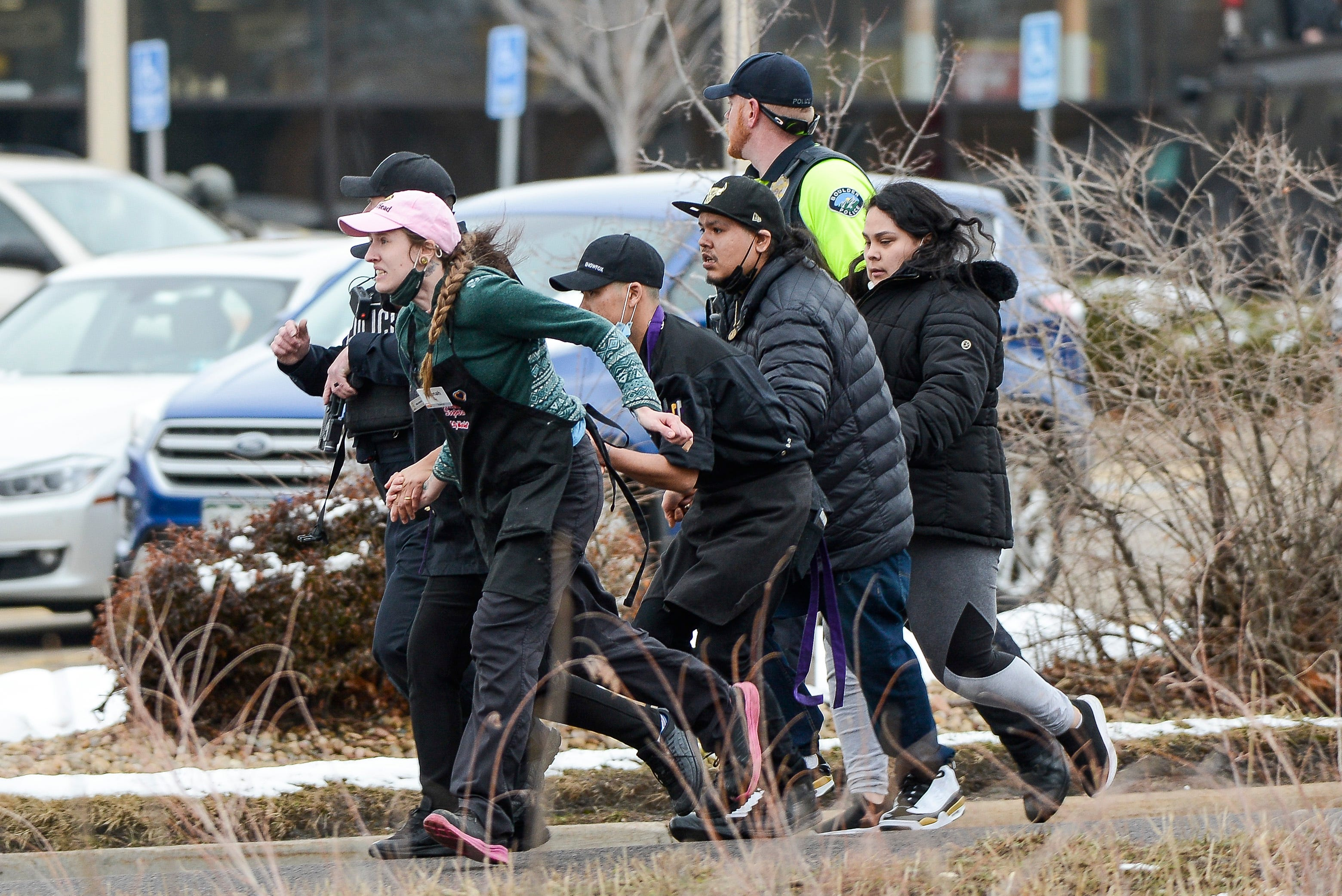 King Soopers employees are led away from an active shooter at the King Soopers grocery store in Boulder Colo. on March 22. 2021.